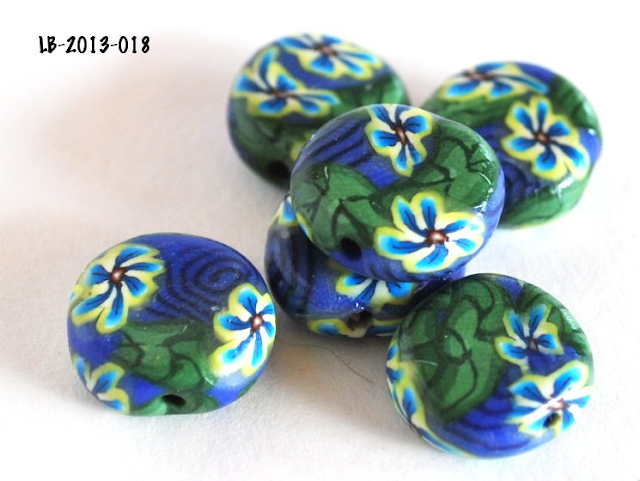 https://www.etsy.com/listing/128596680/yellow-and-blue-flower-beads-with-navy?ref=tre-2724573252-9