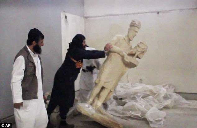 ISIS thugs take a hammer to civilisation Priceless 3,000-year-old artworks smashed to pieces in minutes as militants destroy Mosul museum