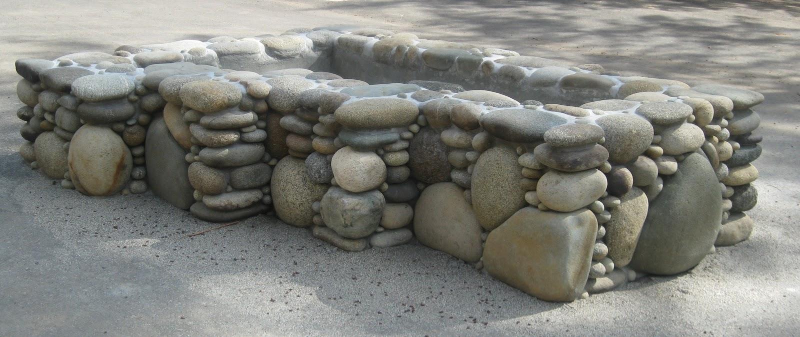 Landscapes gardens design river rock zigzag island planter for Large river rock landscaping