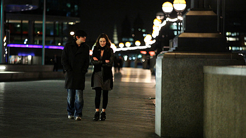 Dating couple taking a stroll in the evening.