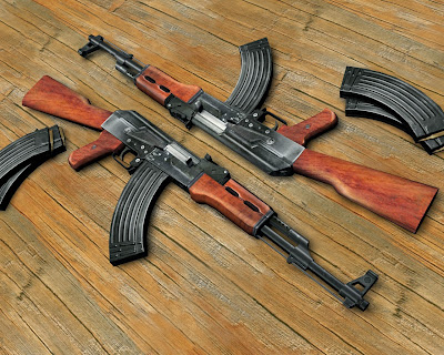 Two AK-47 on wood floor