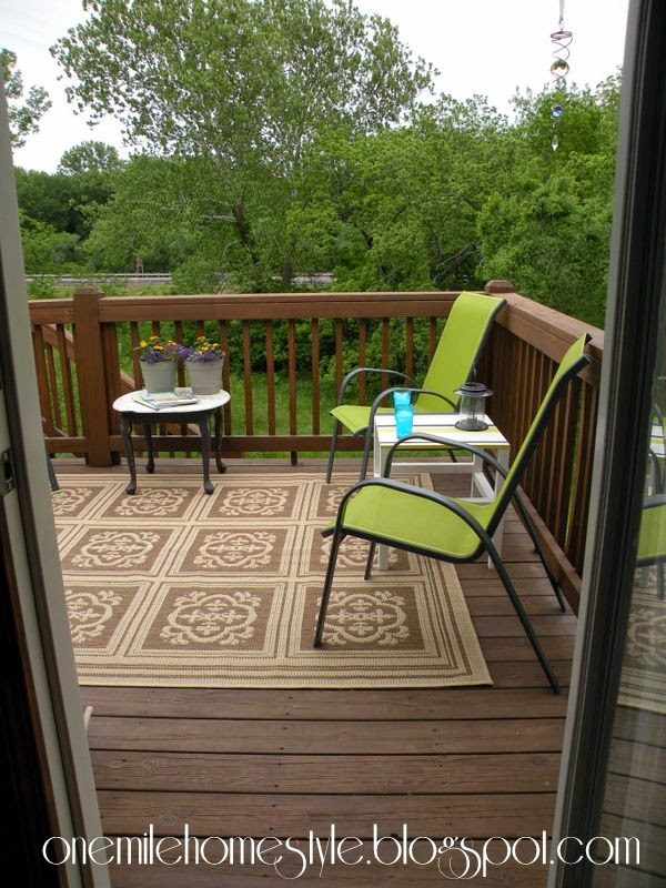 Outdoor living space with green chairs