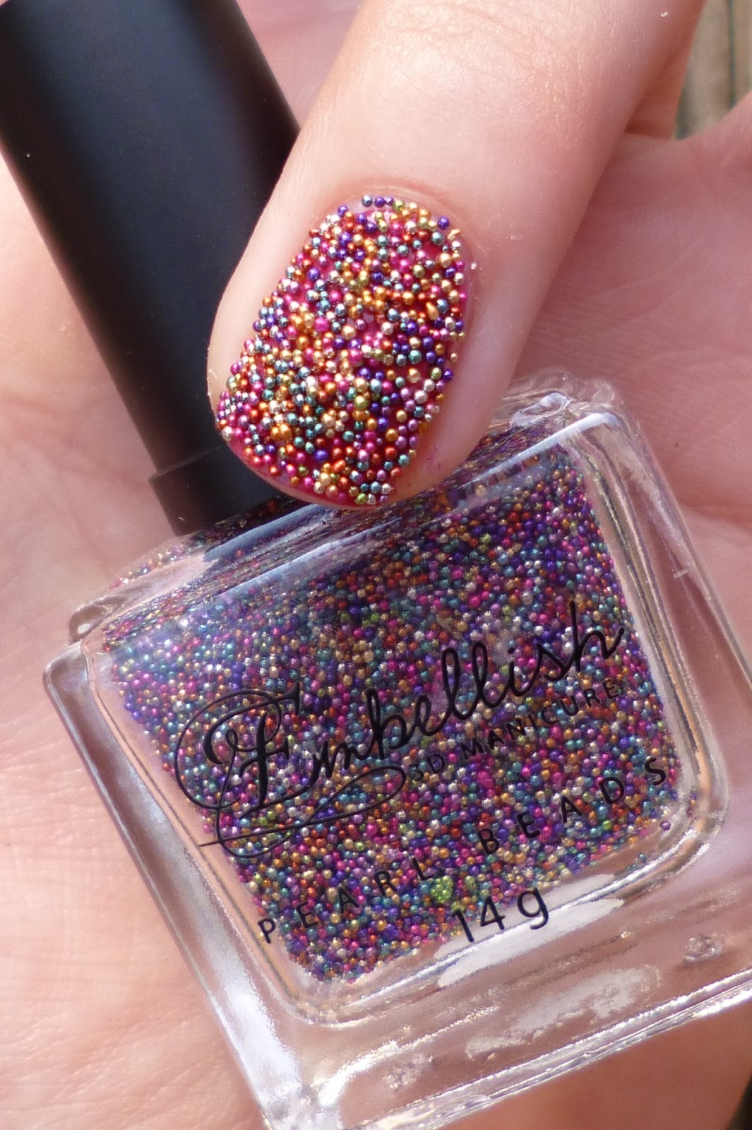 lou is perfectly polished caviar and feather nails