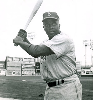 Picture of Jackie Robinson holding a bat like he's ready to swing