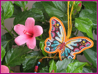Cross stitched butterfly charm on plastic canvas 4