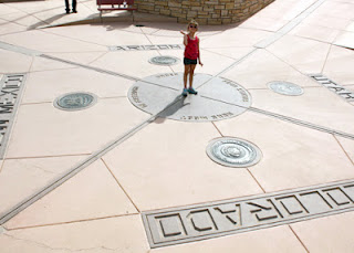 Tessa at Four Corners Monument...standing in four states at once!