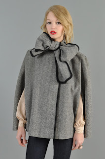Vintage 1980's grey wool herringbone cape with big bow tie closure at neck and black contrast trim.