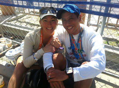 Melissa Adylia Calasanz of Controlled Burn Fitness with Husband, Andrew Calasanz in the beer garden of the Surf City International Marathon 2013
