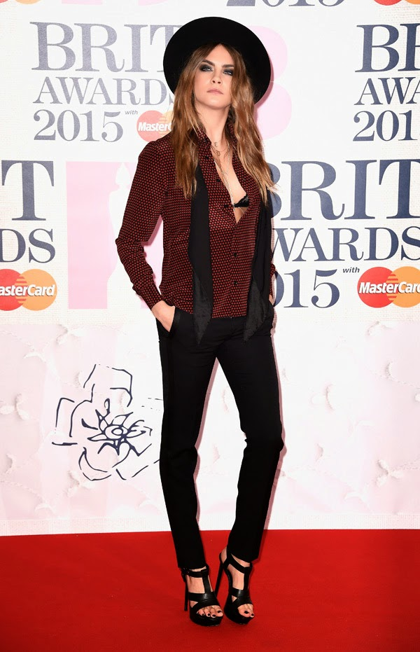 Cara Delevingne wears plunging plaid shirt and trousers to the 2015 BRIT Awards in London