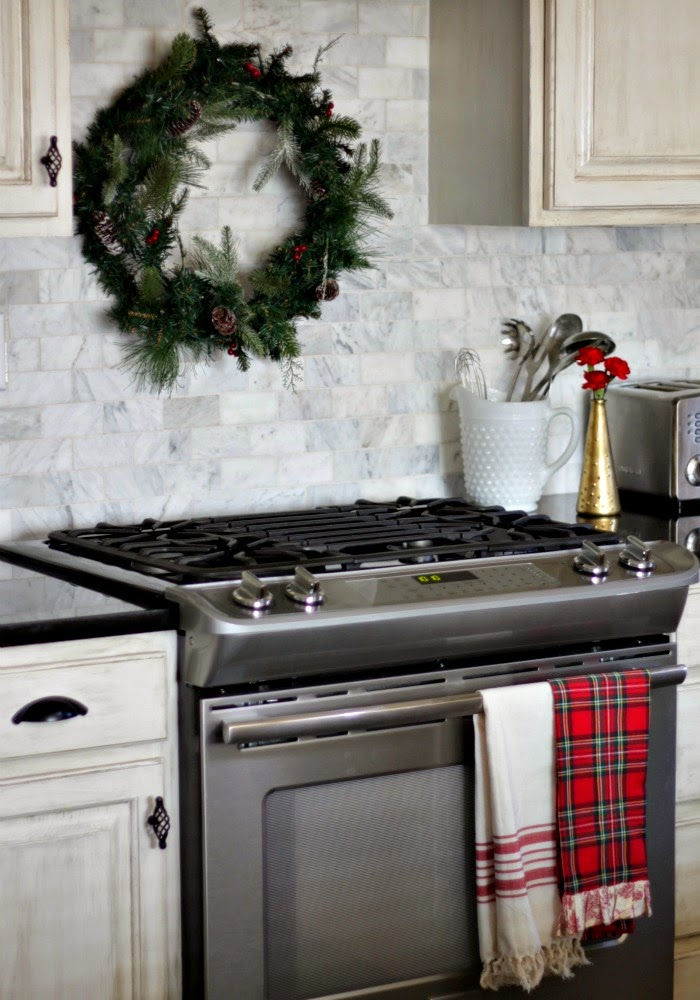 wreath over range and red plaid kitchen towel