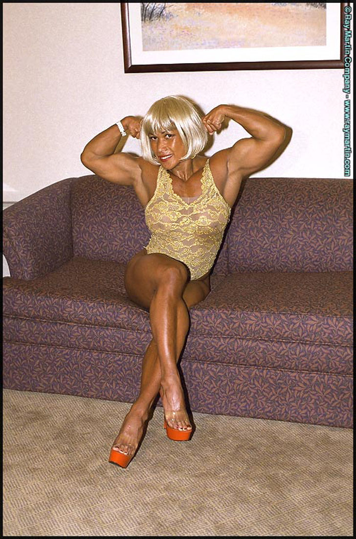 Leilani Dalumpines Flexing Her Biceps And Modeling Her Great Calves In Heels