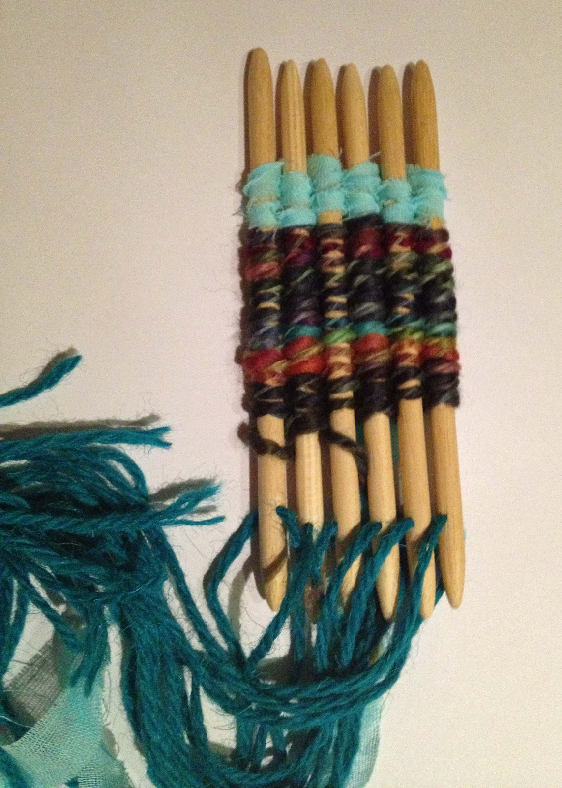 Buttons and paint and a weaving stick dollies kit