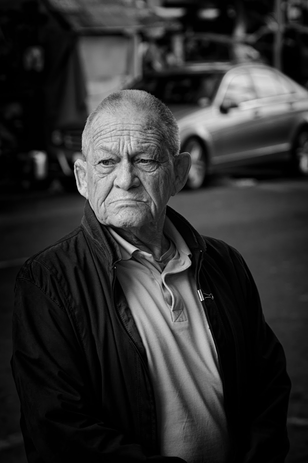 A man in a candid street portrait