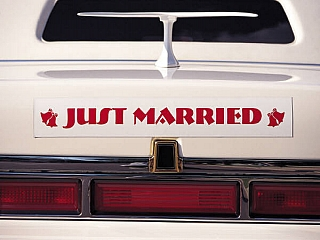 A car with a sign at the back written just marriage