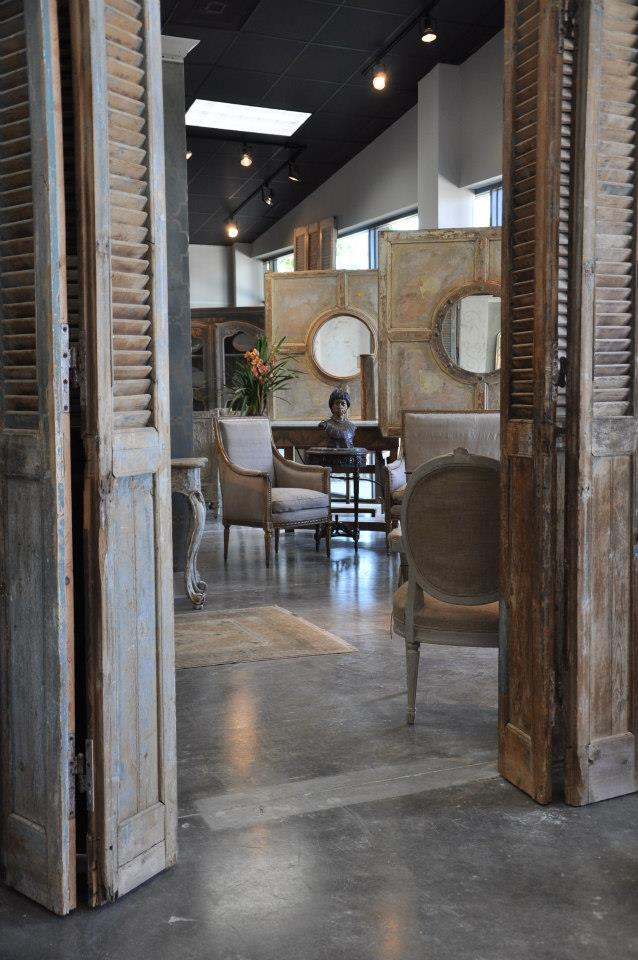 Stunning bifold antique doors in Joyce Horn's new Houston showroom! 7065  Old Katy Road - Marie Flanigan Interiors