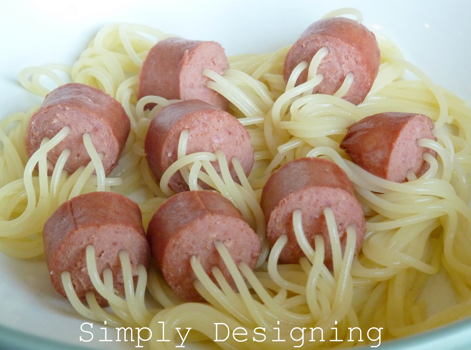 Spaghetti With Hot Dogs Cut Up In It