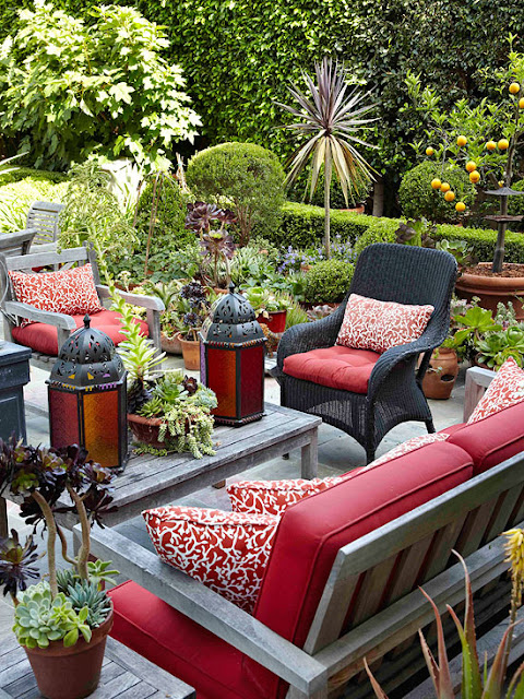 Outdoor Sitting Area wit Red Cushions on Grey Furniture