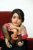 Nidhi Natuiyal Glamorous Photos in Saree-thumbnail-14