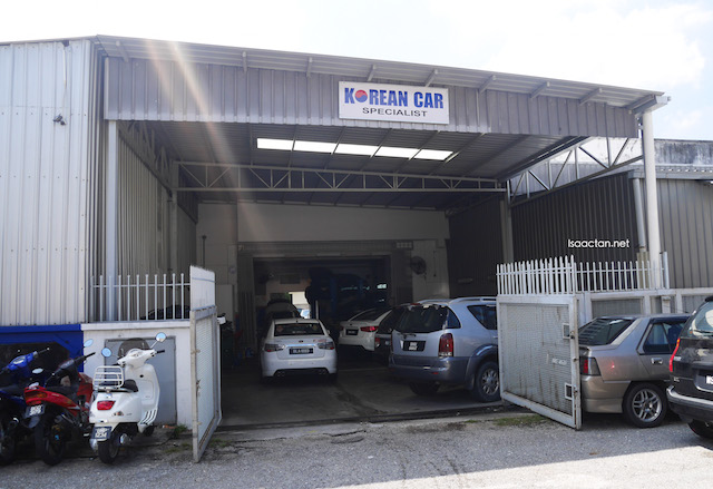 All korean cars are parked at the back for servicing