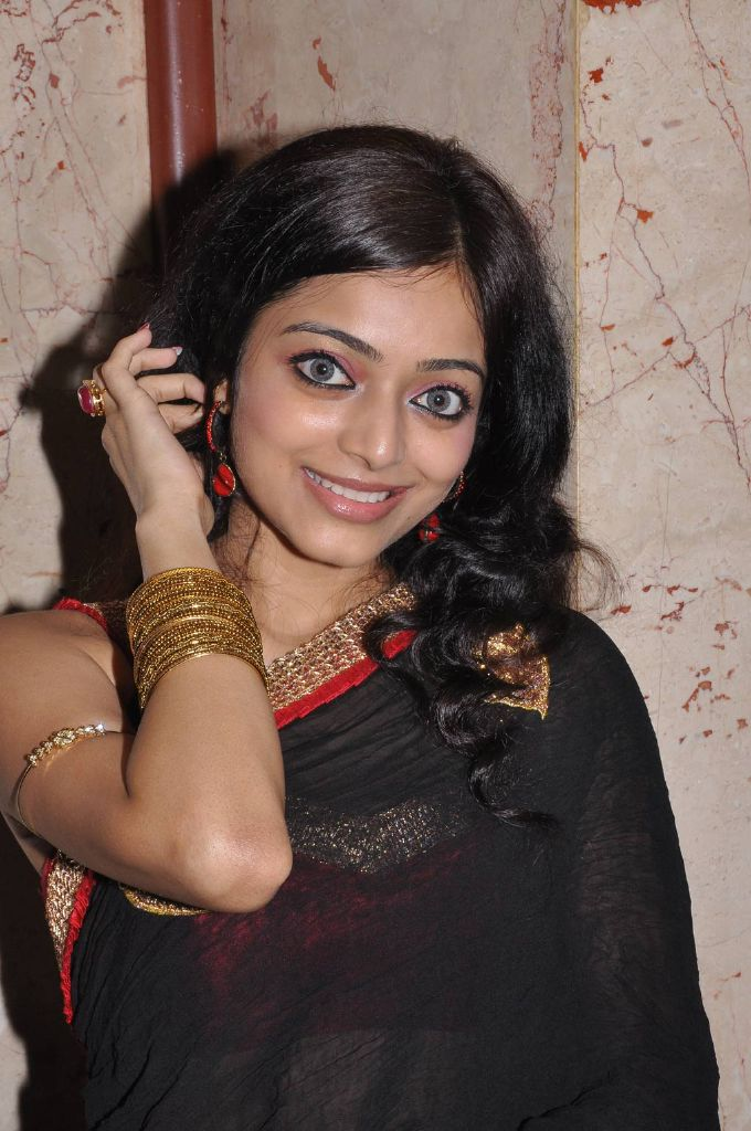 Janani Iyer in a Black Tranparent Saree with Sleevless Tied Blouse