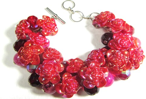 Bracelet has red flower buttons, Fire Polished Czech Beads and Dragon Veins Agate