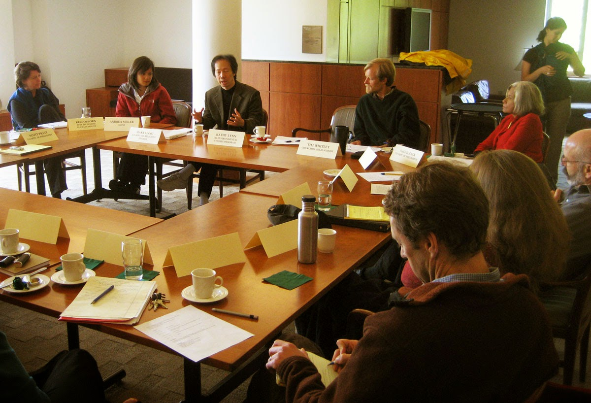 Photo of people in dialogue at a SOPHIA meeting.