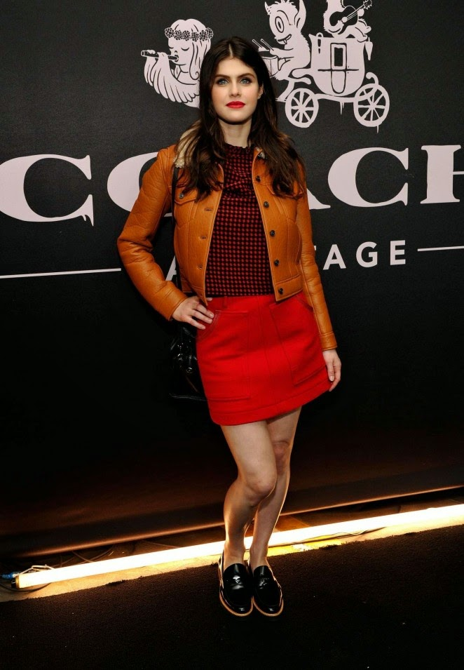 Alexandra Daddario in a red mini skirt at the Coach Rodeo Drive Cocktail Store in Beverly Hills