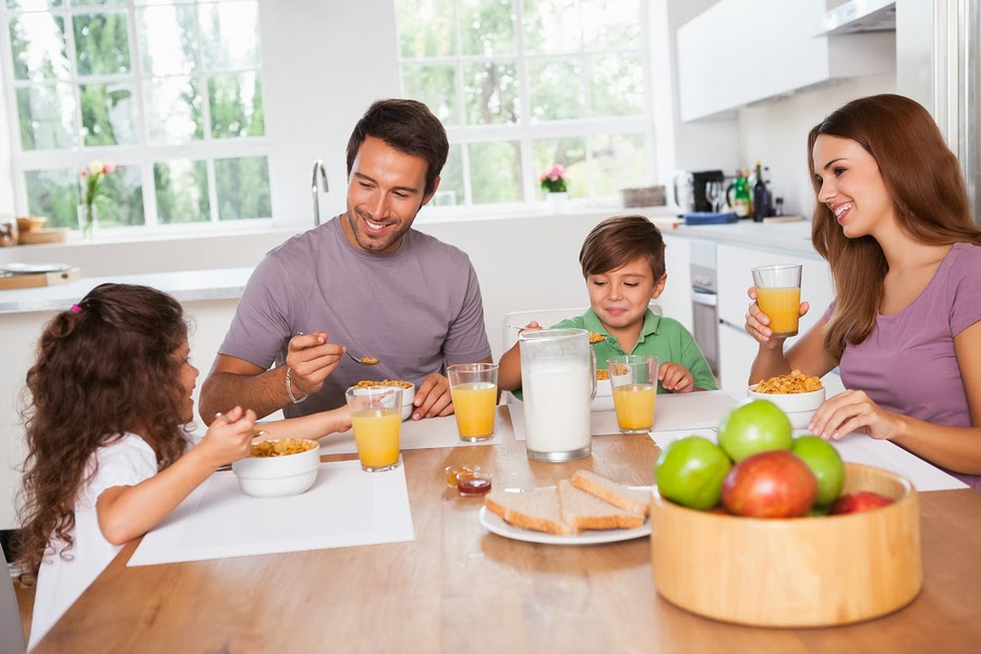Happy family taking meal together on dinning table