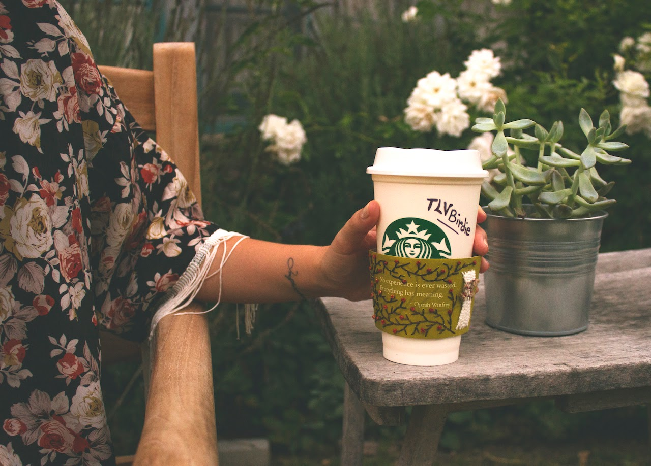 Los Angeles based lifestyle blogger TLV Birdie performed Starbucks cup holders hand stitched embroidery art, emphasizing the Teavana and Oprah's Steep Your Soul campaign in an eco-friendly way.