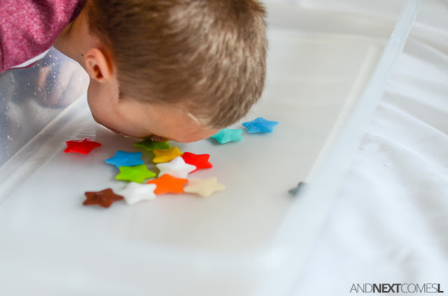 Bobbing for stars sensory bin - a fun oral motor sensory activity for kids from And Next Comes L