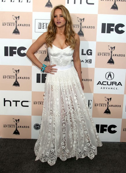 Jennifer Lawrence in a white lacy Dolce and Gabbana Spring 2011 evening dress with a sheer skirt at the 2011 Film Independent Spirit Awards held at the Santa Monica Pier in Santa Monica, CA.