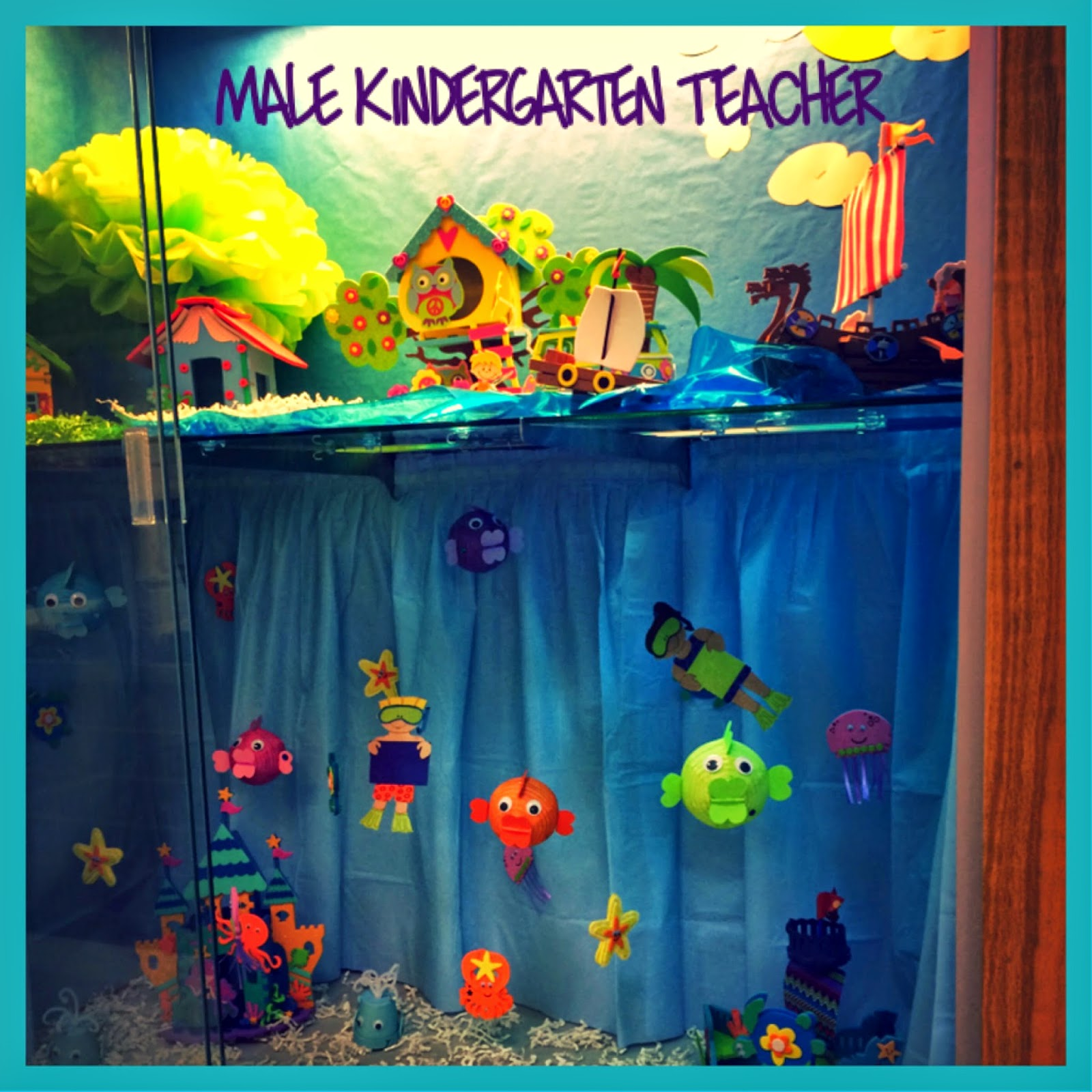 Classroom Decoration Kindergarten ~ Male kindergarten teacher under the sea into a b