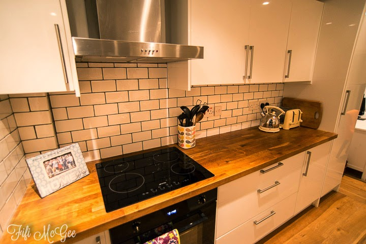 Interior blog - Before & after kitchen tiles: white tiles on black grout