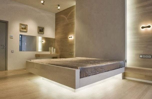 la cama parece elevarse del suelo en este diseo de dormitorio contribuyen para dar esa sensacin las luces colocadas debajo