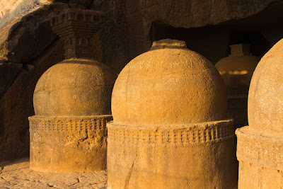 A photograph of the stupas at Bhaja Caves in Pune, India