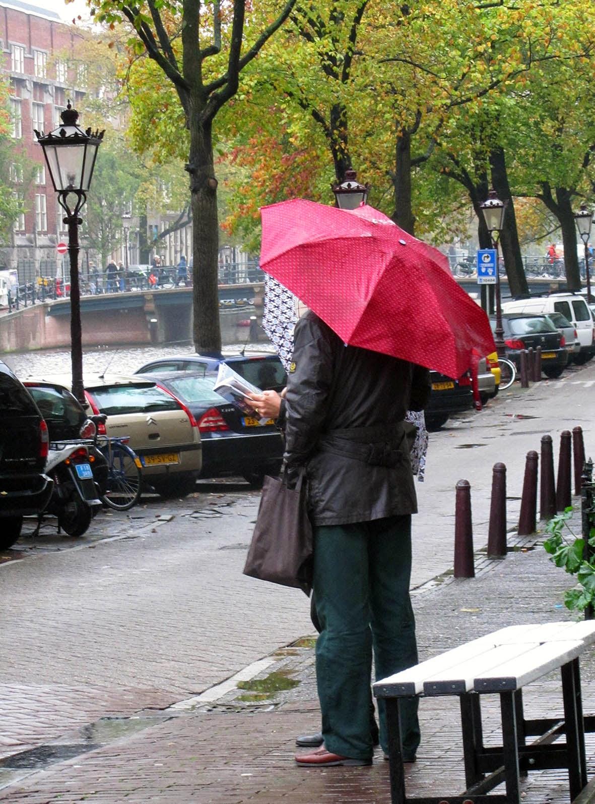 couple under a red umbrella