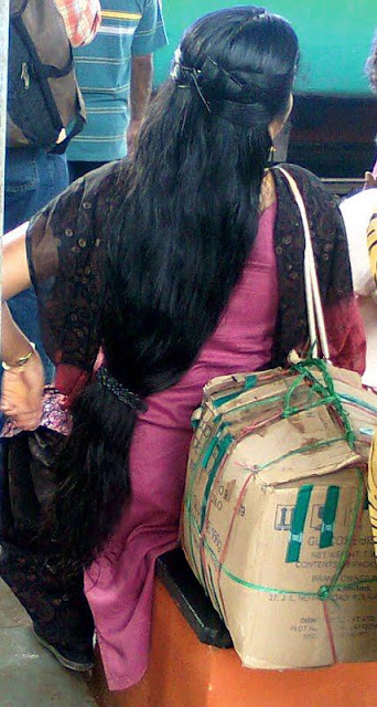Kerala aunt with loose long hair clipped at bottom end.