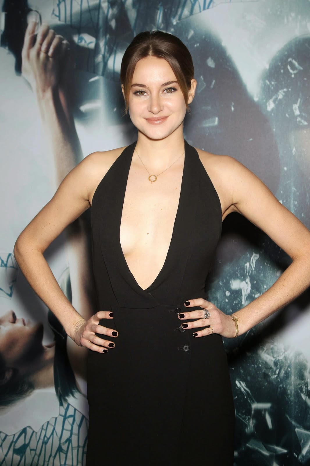 Shailene Woodley wears a plunging black dress to the 'Insurgent' NY premiere