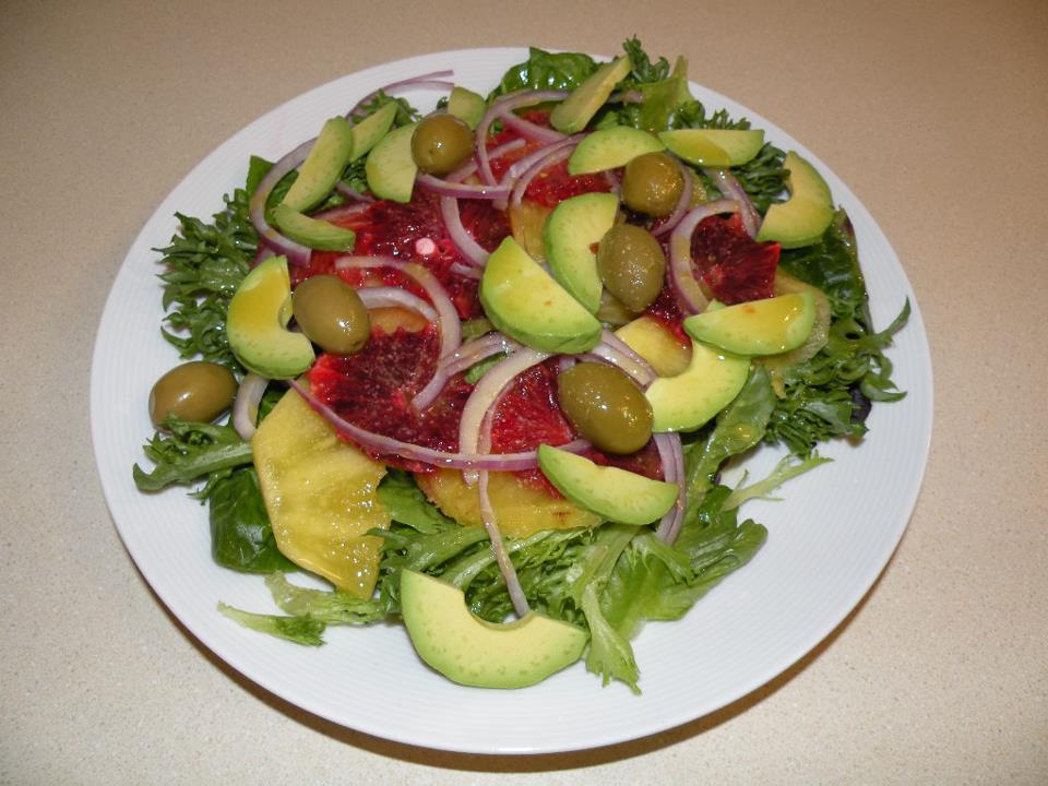 ... orange,pineapple, red onion, arugula, butter lettuce, with a blueberry