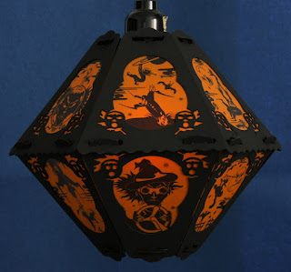 Witches on rockets and witch in goggles decorate vintage style paper lantern for Halloween