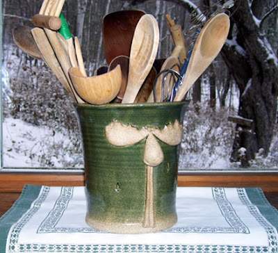 stoneware utensil holder with moose
