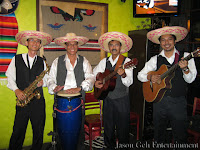 4 piece Mariachi Band comprising of 2 guitarists, a percussionist and a saxophonist