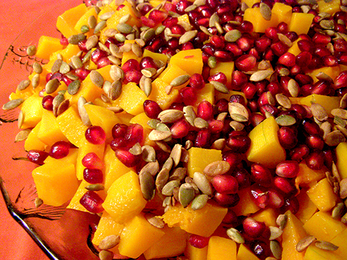 Closeup of Roasted Butternut with Pomegranate and Pumpkin Seeds