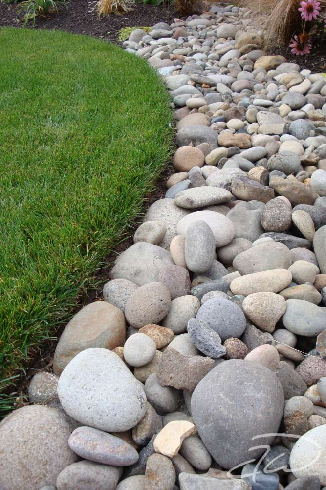 Life in the mediocre lane whatever gets your rocks off for Installing river rock landscaping
