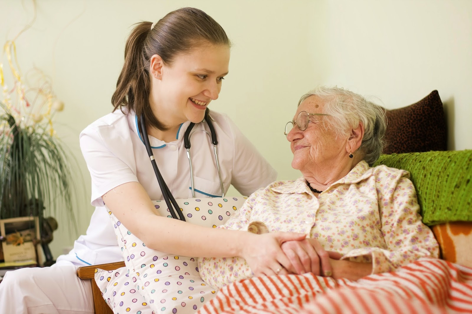Health care provider comforts patient in home setting