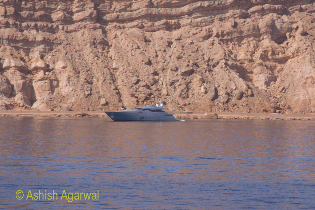Sleep looking yacht on the shore of a cliff at Sharm el Sheikh in the Red Sea in Egypt