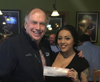 Polar Dip Siren Brittnee Gets a Check from Pearl Street Pub