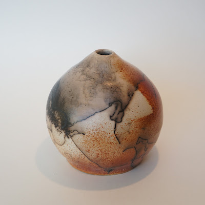 Beautiful horsehair and feather raku pottery vase by Lily.