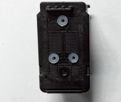tricolor ink cartridge with holes and placed caps