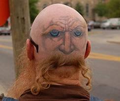 Falso rosto na cabeça tatuagem